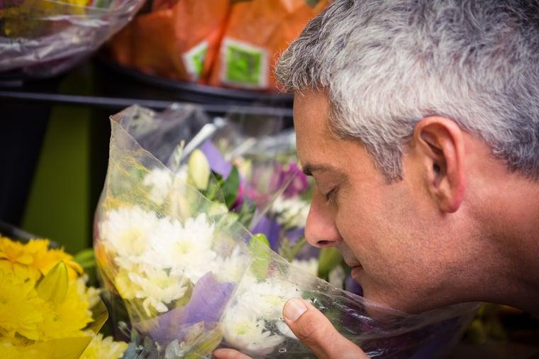 Sensitive Man Enjoying the Scent of Flowers